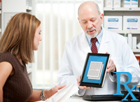 Pharmacist reviewing prescription with patient