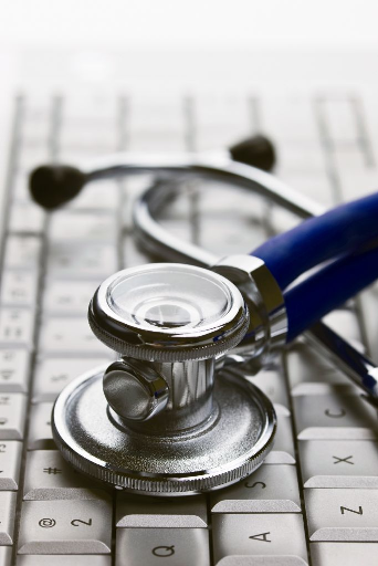 A doctor's stethoscope on a computer keyboard